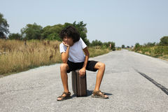 A boy with an old suitcase Stock Photography