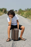 A boy with an old suitcase Stock Images