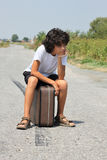 A boy with an old suitcase Royalty Free Stock Photography