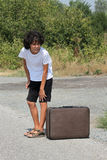 A boy with an old suitcase Stock Photo