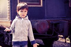 Boy and an old train Royalty Free Stock Image