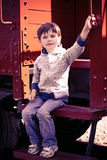 Boy and an old train Stock Images