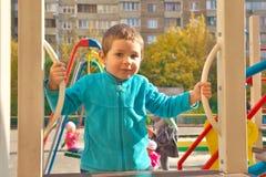 Boy om playground Royalty Free Stock Photos