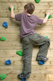 Boy On A Climbing Wall Royalty Free Stock Images