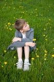 Boy On Dandelion Meadow Stock Image
