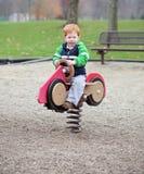Boy On Spring Toy Royalty Free Stock Photos