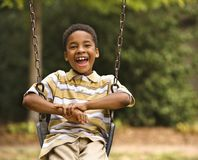 Boy On Swing Royalty Free Stock Photo
