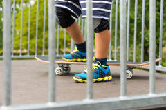 Boy with One Foot on Skateboard on Top of Ramp Royalty Free Stock Images