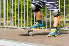 Boy with One Foot on Skateboard on Top of Ramp Royalty Free Stock Photos