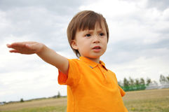 Boy with one hand up Stock Images
