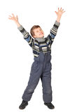 Boy in one-piece suit smile and put his hand up stock images