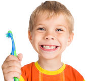 Boy without one teeth with toothbrush stock image