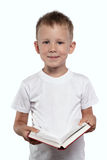 Boy with an open book, isolated on a white. Royalty Free Stock Images