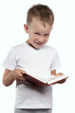 Boy with an open book, isolated on white. Royalty Free Stock Image
