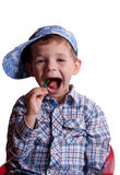 Boy with an open mouth with a lollipop in his hand. On a light background Stock Photography