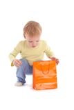 Boy open shopping bag with gift Royalty Free Stock Photos