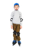 Boy with opened mouth in helmet rollerblading Royalty Free Stock Photo