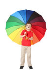 Boy opened mouth with multicolored umbrella Stock Photography