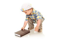 Boy opening a book Stock Photos