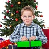 Boy opening christmas gift Royalty Free Stock Photos