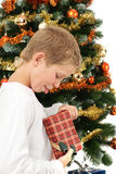 Boy opening christmas present Royalty Free Stock Image