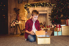 Boy opening christmas present royalty free stock images