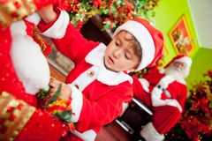 Boy opening Christmas presents Stock Images