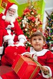 Boy opening Christmas presents Royalty Free Stock Photo