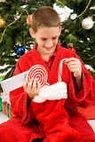 Boy Opening Christmas Stocking Stock Photos