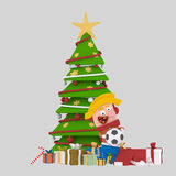Boy  opening gifts in front of a big  Xmas tree.3D. 