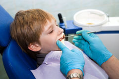 Boy opening his mouth wide during inspection Stock Photo