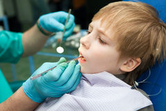 Boy opening his mouth wide during inspection Stock Photography