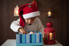 Boy, opening present Stock Photography