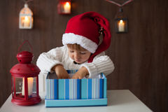 Boy, opening present. On christmas Stock Photo