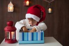 Boy, opening present Stock Photo
