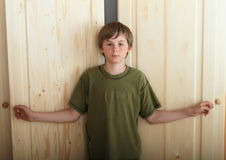 Boy opening wardrobes Royalty Free Stock Photo