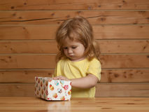 Boy opens box with cakes Royalty Free Stock Image
