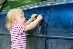 Boy opens car Stock Image