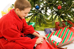 Boy Opens Christmas Present Stock Photo