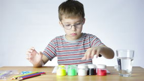 Boy opens jars with paint stock footage