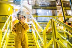 Boy operator recording operation of oil and gas process at oil and rig plant, offshore oil and gas industry, offshore. Oil and rig in the sea, operator monitor royalty free stock photography