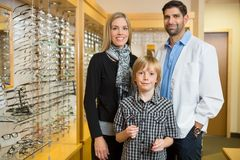 Boy With Optometrist And Mother In Store Stock Photos