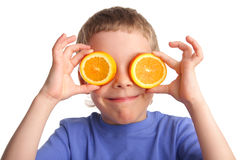 Boy with an orange Stock Images