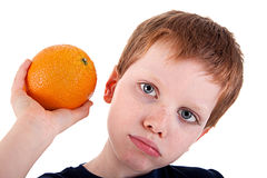 Boy with a orange Royalty Free Stock Image