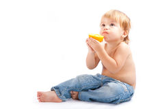 Boy with an orange Royalty Free Stock Photography