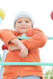 Boy in orange on climbing staircase Royalty Free Stock Image
