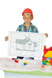 Boy in orange helmet  with house drawing Royalty Free Stock Image