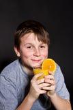 Boy with orange juice Stock Image