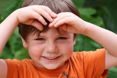 Boy orange shirt Stock Photo
