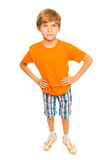 Boy in orange shirt Stock Photo